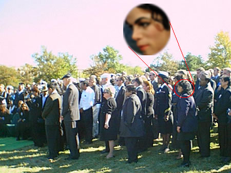 This photo clearly shows Michael Jackson among the attendees at the recent funeral of Senator Ted Kennedy.  Several witnesses came forward stating Jackson showed up at the graveside service thinly disguised as a woman.  This is the only known picture showing Jackson among the mourners.